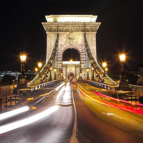 Traffic on Széchenyi Chain bridge over Danube river, Budapest city, Hungary. Night scene